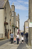 Bridge Street, Kirkwall, Mainland, Orkney. Picture Credit : Iain Sarjeant / Scottish Viewpoint  Tel: +44 (0) 131 622 7174  E-Mail : info@scottishviewpoint.com  Web: www.scottishviewpoint.com This phot... 2012,child,children,kid,kids,family,families,people,person,visitors,visitor,retail,shop,shopping,shops,shopper,shoppers,summer,sunny,island,islands,isle,isles,pedestrianised