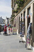 Ola Gorie on Broad Street, Kirkwall, Mainland, Orkney. Picture Credit : Iain Sarjeant / Scottish Viewpoint  Tel: +44 (0) 131 622 7174  E-Mail : info@scottishviewpoint.com  Web: www.scottishviewpoint.c... 2012,child,children,kid,kids,family,families,people,person,visitors,visitor,retail,shop,shopping,shops,shopper,shoppers,summer,sunny,pushchair,specialised,island,islands,isle,isles