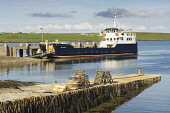 The MV Shapinsay Orkney Islands Council ferry at the harbour at Balfour, Shapinsay, Orkney. Picture Credit : Iain Sarjeant / Scottish Viewpoint  Tel: +44 (0) 131 622 7174  E-Mail : info@scottishviewpo... 2012,summer,sunny,island,islands,isle,isles,coast,coastal,coastline,water,sea,boat,boats,reflection,village,lobster,pots,creels,fishing