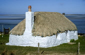 A traditional thatched croft house overlooking the coast, North Uist, Outer Hebrides. Andrew Wilson / Scottish Viewpoi 2014,winter,spring,north,uist,Outer,Hebrides,island,islands,isle,isles,western,coast,coastal,coastline,water,sea,beach,beaches,sand,sandy,sands,tradition,traditional,croft,house,houses,housing,thatche