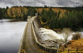 Loch Laggan dam with water overflowing, Lochaber, with snow covered mountains beyond, Highlands of Scotland. Andrew Wilson / Scottish Viewpoi 2014,winter,loch,laggan,highlands,highland,scotland,atmospheric,atmosphere,mountain,mountains,hill,hills,snow,cold,weather,forestry,forest,forests,water,overflow,overflowing,flow,flows,flowing,energy,
