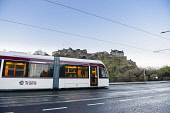 Edinburgh Trams running along Princes Street with Edinburgh Castle behind, in the city centre of Edinburgh Simon Williams / Scottish Viewpo 2014,blue,sky,cities,city,edinburgh,castle,tram,trams,tracks,wire,wires,princes,street,streets,transport,travel,travelling,attraction,attractions,visitor,tourist,architecture,architectural,building,bu