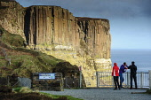 Tourists at the viewpoint for the dramatic rock formations of Kilt Rock, Isle of Skye, Inner Hebrides. Andrew Wilson / Scottish Viewpoi 2014,winter,spring,sunny,sunshine,atmosphere,atmospheric,inner,Hebrides,island,islands,isle,isles,coast,coastal,coastline,water,sea,dramatic,cliff,cliffs,highland,rock,formation,skye,volcanic,people,t