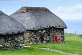 Traditional thatched crofts at the Skye Museum of Island Life, Kilmuir, Isle of Skye, Inner Hebrides. Andrew Wilson / Scottish Viewpoi 2014,winter,spring,inner,Hebrides,island,islands,isle,isles,attraction,visitor,visitors,old,millstone,millstones,skye,museum,life,highland,tradition,traditional,thatch,thatched,equipment,farm,farming,