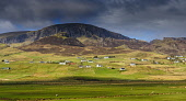 The view over the dispersed settlement of Staffin towards the Trotternish Ridge, Isle of Skye, Inner Hebrides. Andrew Wilson / Scottish Viewpoi 2014,winter,spring,sunny,sunshine,inner,hebrides,island,islands,isle,isles,mountain,mountains,hill,hills,panoramic,panorama,Skye,staffin,trotternish,ridge,peninsula,highland,cliff,cliffs,house,houses,