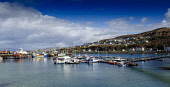 Boats moored in the harbour of the port of Mallaig, Lochaber, Highlands of Scotland. Andrew Wilson / Scottish Viewpoi 2014,winter,spring,sunny,sunshine,port,Mallaig,boat,boats,fishing,yacht,yachts,panorama,panoramic,jetty,pontoon,pontoons,house,houses,housing,village