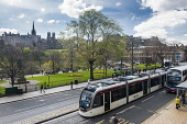 Edinburgh Trams running along Princes Street with Princes Street Gardens and Edinburgh Castle behind, in the city centre of Edinburgh Simon Williams / Scottish Viewpo 2014,blue,sky,cities,city,edinburgh,castle,tram,trams,tracks,wire,wires,princes,street,streets,transport,travel,travelling,attraction,attractions,visitor,tourist,architecture,architectural,building,bu