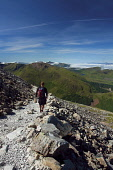 A walker descending the path from the summit of Ben Nevis, with a view over Glen Nevis towards the Mamores and the mountains of Morvern beyond, Lochaber, Highlands of Scotland. Keith Fergus / Scottish Viewpoin 2014,horizontal,summer,sunny,sunshine,blue,sky,day,Lochaber,Ben,Nevis,Mountain,Mountains,Munro,Highland,Highlands,outdoor,Outdoors,Health,Recreation,Scotland,UK,United Kingdom,U.K,activity,activities,