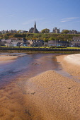 The sandy beach at Lossiemouth, Moray, Scotland, UK Dennis Barnes / Scottish Viewpoi 2014,spring,sunny,sunshine,blue,sky,skies,day,Lossiemouth,river,Lossie,Moray,Scotland,Scottish,UK,U.K,United,Kingdom,vertical,town,housing,houses,church,spire,steeple,beach,beaches,sand,sandy,coast,co