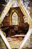 Looking through a broken pane of glass to the interior of a dilapidated church near Gairlochy, Highlands of Scotland. Kenny Ferguson / Scottish Viewpo 2014,vertical,interior,no people,nobody,Scotland,Scottish,UK,U.K,Great,Britain,dilapidated,disued,abandoned,crumbling,pews,fifty,eight,fifty-eight,58,atmospheric,atmosphere,ruinous,window,leaded,diamo