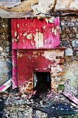 The interior of a dilapidated cottage at Banavie, Highlands of Scotland. Kenny Ferguson / Scottish Viewpo 2014,vertical,interior,no people,nobody,Scotland,Scottish,UK,U.K,Great,Britain,dilapidated,disued,abandoned,crumbling,atmospheric,atmosphere,ruinous,ruin,ruined,fire,place,fireplace,graffiti,vandalism