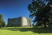 The substantial remains of Dunstaffnage Castle, Argyll, Scotland. Keith Fergus / Scottish Viewpoin 2014,horizontal,summer,sunny,sunshine,no people,nobody,Scotland,Scottish,UK,U.K,Great,Britain,Dunstaffnage,trees,blue,sky,skies,day,building,history,heritage,historic,hs,remains,attraction,attractions
