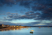 Small boats moored in Findhorn Bay at sunset, Findhorn, Moray, Scotland. Keith Fergus / Scottish Viewpoin 2014,horizontal,summer,sky,skies,no people,nobody,Scotland,Scottish,UK,U.K,Great,Britain,clouds,cloud,evening,sunset,small,boats,sailing,dinghies,atmospheric,atmosphere,coast,coastal,coastline,water,s