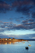 Small boats moored in Findhorn Bay at sunset, Findhorn, Moray, Scotland. Keith Fergus / Scottish Viewpoin 2014,vertical,summer,sky,skies,no people,nobody,Scotland,Scottish,UK,U.K,Great,Britain,clouds,cloud,evening,sunset,small,boats,sailing,dinghies,atmospheric,atmosphere,coast,coastal,coastline,water,sea