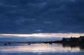 Small boats moored in Findhorn Bay at dusk, Findhorn, Moray, Scotland. Keith Fergus / Scottish Viewpoin 2014,horizontal,summer,sky,skies,no people,nobody,Scotland,Scottish,UK,U.K,Great,Britain,clouds,cloud,evening,sunset,silhouette,small,boats,sailing,dinghies,atmospheric,atmosphere,coast,coastal,coastl
