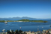 Looking down to Oban Bay from McCaig's Tower, Oban, with the Island of Kerrera in the middle distance and the Isle of Mull beyond, Argyll, Scotland. Keith Fergus / Scottish Viewpoin 2014,horizontal,summer,sunny,sunshine,blue,sky,skies,no people,nobody,Scotland,Scottish,UK,U.K,Great,Britain,day,coast,coastal,coastline,water,island,islands,isle,isles,Kerrera,Oban,Argyll,bay,mountai