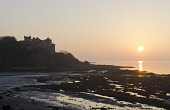 The view to Culzean Castle from the beach at sunset, by Maybole, South Ayrshire, Scotland. Allan Wright / Scottish Viewpoin 2013,horizontal,sunset,evening,dusk,orb,winter,no people,nobody,South,Ayrshire,Scotland,Scottish,UK,U.K,Great,Britain,atmospheric,atmosphere,Culzean,Castle,Maybole,Firth,Clyde,beach,sand,sandy,coast,c