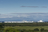 The UPM Caledonian Paper Mill, Irvine, with a view beyond across the Firth of Clyde to the Isle of Arran, North Ayrshire, Scotland. Allan Wright / Scottish Viewpoin 2013,horizontal,day,summer,sunny,sunshine,blue,sky,skies,no people,nobody,North,Ayrshire,Scotland,Scottish,UK,U.K,Great,Britain,UPM,Caledonian,Paper,Mill,Irvine,Firth,Clyde,Isle,Island,Arran,factory,b