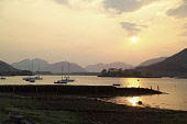 Yachts moored on Loch Leven at sunset, with the Ballachulish Bridge visible, Highlands of Scotland. Allan Wright / Scottish Viewpoin horizontal,evening,sunset,atmospheric,atmosphere,summer,water,Highland,Highlands,Lochaber,no people,nobody,Scottish,UK,U.K,Great,Britain,hills,mountains,Loch,Leven,activity,activities,sailing,boats,ya