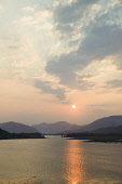 Loch Leven at sunset, with the Ballachulish Bridge visible, Highlands of Scotland. Allan Wright / Scottish Viewpoin vertical,evening,sunset,atmospheric,atmosphere,summer,water,Highland,Highlands,Lochaber,no people,nobody,Scottish,UK,U.K,Great,Britain,hills,mountains,Loch,Leven,activity,activities,sailing,boats,yach