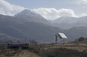 A Scotrail train passes the Our Lady of the Braes Roman Catholic Church by Lochailort on the West Highland Line, Highlands of Scotland. Allan Wright / Scottish Viewpoin horizontal,day,winter,Highland,Highlands,Lochaber,Lochailort,no people,nobody,Scottish,UK,U.K,Great,Britain,hills,mountains,Scotrail,train,travelling,transport,west,line,snow,dusting