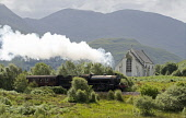 The Jacobite Steam Train passes the Our Lady of the Braes Roman Catholic Church by Lochailort on the West Highland Line, Highlands of Scotland. Allan Wright / Scottish Viewpoin horizontal,day,summer,sunny,Highland,Highlands,Lochaber,Lochailort,no people,nobody,Scottish,UK,U.K,Great,Britain,hills,mountains,train,travelling,transport,west,line,attraction,attractions,visitor,to