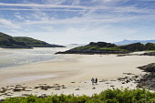 A couple walk on the Silver Sands of Morar on the west coast of the Highlands of Scotland. Allan Wright / Scottish Viewpoin horizontal,day,summer,sunny,coast,coastal,coastline,water,sea,couple,one,man,woman,two,people,40-50,years,sand,sandy,sands,beach,silver,Morar,romantic,romance,blue,sky,skies,empty