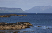 Looking towards Eigg and Rum from the coast near Arisaig, Highlands of Scotland. Iain McLean / Scottish Viewpoint horizontal,day,summer,sunny,sunshine,blue,sky,skies,Arisaig,Lochaber,Eigg,Rum,Rhum,island,islands,isle,isles,coast,coastal,coastline,water,sea,activity,activities,sailing,boat,yacht,lone,Scotland,Scot
