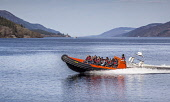 A fast rib boat trip on  Loch Ness  near Fort Augustus, Highlands of Scotland. Laurence Leech / ScottishViewpoi horizontal,outdoors,outside,spring,sunny,sunshine,day,people,group,Scotland,Scottish,UK,U.K,Great Britain,Highlands,hills,water,Loch Ness,Fort Augustus,fast rib,boatm,trip,inflatable