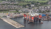 An aerial view of oil platform moored at Invergordon, Highlands of Scotland. Laurence Leech / ScottishViewpoi horizontal,outdoors,outside,summer,day,no people,nobody,overcast,Scotland,Scottish,UK,U.K,Great Britain,Highlands,coast,coastal,water,sea,Oil Platform,rig,Cromarty Firth,Nigg Hill,industry,aerial,Inve