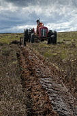 Peat cutting in the Highlands. Mike Brookes Roper / Scottish Vi vertical,outside,outdoors,day,peat,cutting,tractor,crofter,crofting,Scotland,Scottish,UK,U.K,Great Britain,Highlands,one man only,60-65 years,1 person,elderly,moorland,tradition,traditional,fossil fue