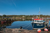 A fishing boat moored at the small harbour at Badachro on Loch Gairloch, Highlands of Scotland. D.G.Farquhar / Scottish Viewpoin horizontal,outdoors,outside,day,autumn,sunny,blue sky,skies,bay,Badachro,Highlands,Scotland,Scottish,UK,U.K,Great Britain,calm,coast,coastal,coastline,water,nobody,small boats,moored,reflection,reflec