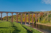 The disused railway viaduct at Leaderfoot over the River Tweed near Melrose, Scottish Borders, Scotland. D.G.Farquhar / Scottish Viewpoin horizontal,outdoors,outside,day,autumn,sunny,blue sky,skies,Leaderfoot,Scottish Borders,Scotland,Scottish,UK,U.K,Great Britain,autumnal,railway,viaduct,bridge,water,disused,River Tweed,nobody