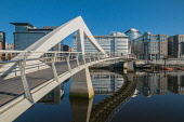 Tradeston Bridge or the Squiggly Bridge over the River Clyde  at Broomielaw, Glasgow, Scotland. D.G.Farquhar / Scottish Viewpoin horizontal,outdoors,outside,day,spring,sunny,blue sky,skies,Tradeston Bridge,footbridge,Broomielaw,Glasgow,city,Squiggly Bridge,Scotland,Scottish,UK,U.K,Great Britain,people,structure,engineering,wate