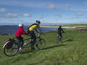 Cycling along the coast at Birsay on Orkney's West Mainland, Orkney, Scotland. Mark Ferguson/ Scottish Viewpoin 10-20,years,40-50,3 people,activity,activities,cycling,cyclist,cyclists,bike,bikes,biking,biker,bikers,bicycle,bicycles,mountain,tandem bike,Scotland,Scottish,UK,U.K,Great Britain,outdoors,daytime,coa