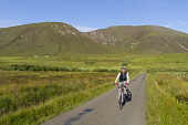 Male cyclist on a single track road by Ward Hill, Isle of Hoy,  Orkney, Scotland. Mark Ferguson/ Scottish Viewpoin active,bicycle,bike,countryside,cycle,cycling,enjoying,fit,fun,happy,healthy,lifestyle,male,man,outdoors,people,relaxed,relaxing,ride,riding,activity,recreation,vacation,holiday,Orkney,isles,islands,S
