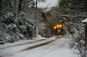 A snow plough clearing a rural road near Biggar, South Lanarkshire, Scotland. Andrew Wilson / Scottish Viewpoi horizontal,outside,outdoors,exterior,winter,day,weather,gloomy,snow,dark,rural,plough,road,snow plough,tractor,1 person,one man only,driver,Biggar,South Lanarkshire,countryside,country road,Scotland,S