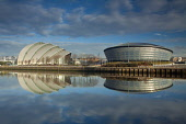 The view over a mirror calm River Clyde to The Armadillo, the SSE Hydro from Pacific Quay, west of the city centre of Glasgow, Scotland. Keith Fergus / Scottish Viewpoin horizontal,outside,outdoors,day,winter,sunny,sunshine,blue sky,clouds,Glasgow,River Clyde,The Armadillo,The SSE Hydro,Clyde Auditorium,SECC,Pacific Quay,regeneration,reflection,calm,mirror,water,city,