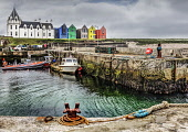 Looking over the harbour to the new Scandinavian style brightly coloured tourist accommodation extension to the restored hotel at John O' Groats, Caithness, Highlands of Scotland. Bill McKenzie / Scottish Viewpoi horizontal,outside,outdoors,day,summer,John O Groats,village,harbour,boats,Caithness,Highland,Scotland,Scottish,UK,U.K,Great Britain,nobody,building,hotel,accommodation,HDR,coast,coastal,coastline,wat