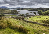 A house overlooking Loch Inchard with Arkle and Ben Stack visible beyond, Sutherland, Highlands of Scotland Bill McKenzie / Scottish Viewpoi horizontal,outside,outdoors,day,summer,cloudy,Loch Inchard,Arkle,Ben Stack,Sutherland,Highland,Scotland,Scottish,UK,U.K,Great Britain,nobody,house,building,HDR,atmospheric,water