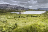 An abandoned cottage by Loch Stack with mountains beyond, Sutherland, Highlands of Scotland Bill McKenzie / Scottish Viewpoi horizontal,outside,outdoors,day,summer,cloudy,Loch  Stack,Sutherland,Highland,Scotland,Scottish,UK,U.K,Great Britain,nobody,building,HDR,atmospheric,water,abandoned,croft,cottage,bothy,mountains,remot