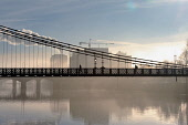The South Portland Street Suspension Bridge over the River Clyde on a misty morning, Glasgow, Scotland. Tony Clerkson / Scottish Viewpoi horizontal,outside,outdoors,exterior,winter,morning,sunny,sunshine,weather,Glasgow,Green,city,fog,foggy,mist,misty,cold,wintry,freezing fog,silhouette,atmospheric,Scotland,Scottish,UK,U.K,Great Britai