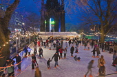The ice rink by the Scott Monument in East Princes Street Gardens - part of Edinburgh's Christmas, in the city centre of Edinburgh. Dennis Barnes / Scottish Viewpoi horizontal,outside,outdoors,evening,dusk,night,winter,Scott Monument,East Princes Street Gardens,Edinburghs Christmas,city,Edinburgh,Scotland,Scottish,UK,U.K,Great Britain,people,crowd,ice rink,skatin
