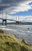 Kayakers by the Kessock Bridge, carrying the A9 road over the Beauly Firth, Highlands of Scotland. Dennis Barnes / Scottish Viewpoi vertical,outside,outdoors,day,autumn,sunny,sunshine,blue sky,Kessock Bridge,Beauly Firth,North Kessock,Scotland,Scottish,UK,U.K,United Kingdom,people,group,kayaker,kayak,kayaking,paddling,activity,tra