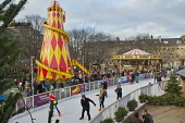 The circular ice rink in St Andrew Square - part of Edinburgh's Christmas, in the city centre of Edinburgh. Dennis Barnes / Scottish Viewpoi horizontal,outside,outdoors,day,winter,St Andrew Square,Edinburghs Christmas,city,Edinburgh,Scotland,Scottish,UK,U.K,Great Britain,people,crowd,ice rink,skating,children,kids,xmas,fairground,helter sk