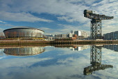 The view over a mirror calm River Clyde to the SSE Hydro and the Finnieston Crane also visible, west of the city centre of Glasgow, Scotland. Keith Fergus / Scottish Viewpoin horizontal,outside,outdoors,day,winter,sunny,sunshine,blue sky,clouds,Glasgow,River Clyde,The SSE Hydro,Finnieston Crane,regeneration,reflection,calm,mirror,water,city,building,architecture,Scotland,S