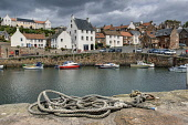 Boats at the quayside in the harbour of Crail, a fishing village on the East Neuk of Fife, Scotland Ross Graham/ Scottish Viewpoint Crail,Fife,East Neuk,uk,u.k,Great Britain,GB,G.B,Scotland,Scottish,summer,sunny,house,cottage,outdoors,outside,pantile roof,harbour,boat,boats,fishing,coast,coastal,coastline,water,sea,fife coastal pa