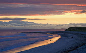 Sunset over the sea and beach with a lone fisherman on the beach, North Uist, Outer Hebrides, Scotland Allan Wright/ Scottish Viewpoint 1 person,North Uist,Outer Hebrides,beach,beaches,sand,sandy,coast,coastal,coastline,water,sea,uk,u.k,Great Britain,GB,G.B,Scotland,Scottish,sunset,dusk,outdoors,island,islands,isle,isles,Western Isles