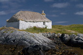 A traditional thatched cottage on the coast on North Uist, Outer Hebrides, Scotland Allan Wright/ Scottish Viewpoint North Uist,Outer Hebrides,uk,u.k,Great Britain,GB,G.B,Scotland,Scottish,Western Isles,nobody,outdoors,summer,sunny,island,islands,isle,isles,croft,blackhouse,tradition,thatched roof,crofts