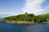 The ivy clad ruins of Dunollie Castle near Oban, Argyll, Scotland. Allan Wright / Scottish Viewpoin horizontal,outdoors,outside,day,summer,sunny,blue sky,Dunollie Castle,Oban,Argyll,Scotland,Scottish,UK,U.K,Great Britain,nobody,history,heritage,ruin,ruined,ivy clad,building,coast,coastal,coastline,w